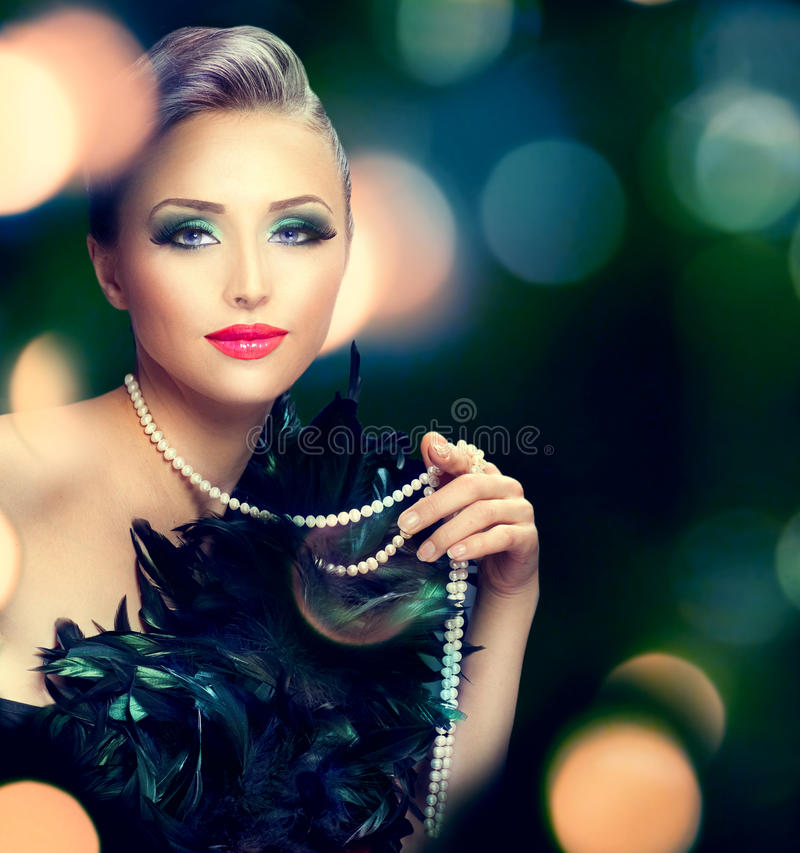 Beautiful luxury woman portrait. Over dark blurred background royalty free stock photography
