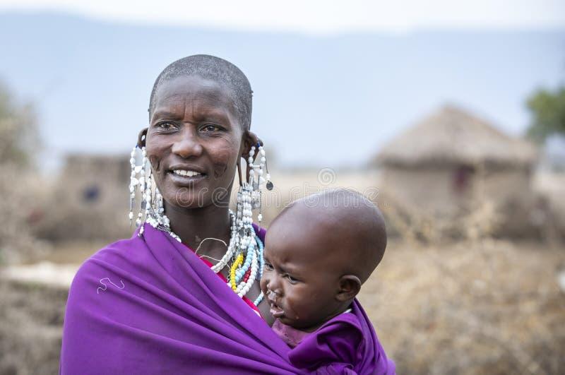 Beautiful maasai woman with a kid royalty free stock image