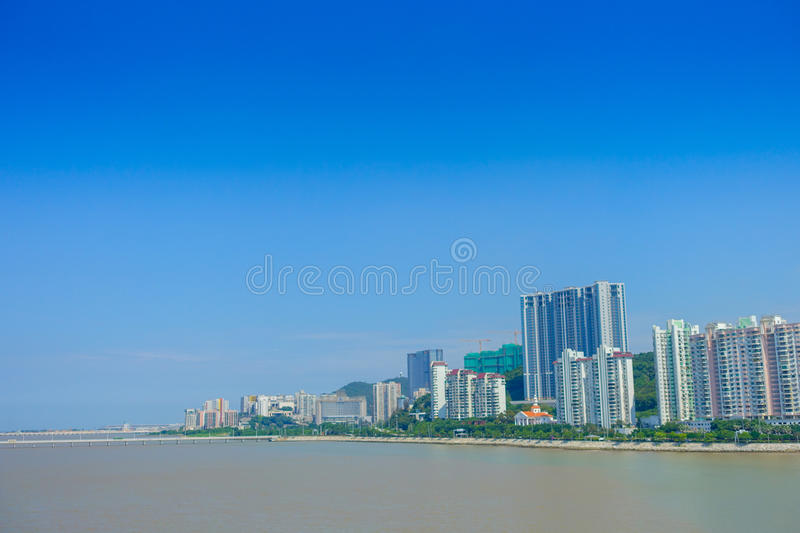 Beautiful Macao city in the horizont with some modern buildings in a beautiful blue sky stock photos