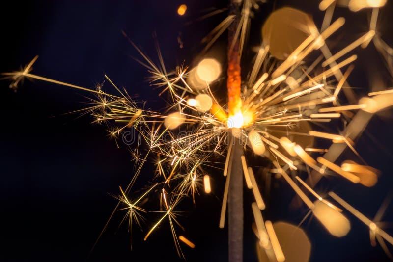 Beautiful macro closeup of a sparkler at night stock images