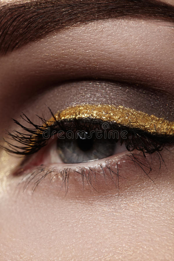 Download Beautiful Macro Shot Of Female Eye With Ceremonial Makeup. Perfect Shape Of Eyebrows, Eyeliner And Pretty Gold Line On Eyelid Stock Photo - Image of eyelashes, color: 64916282