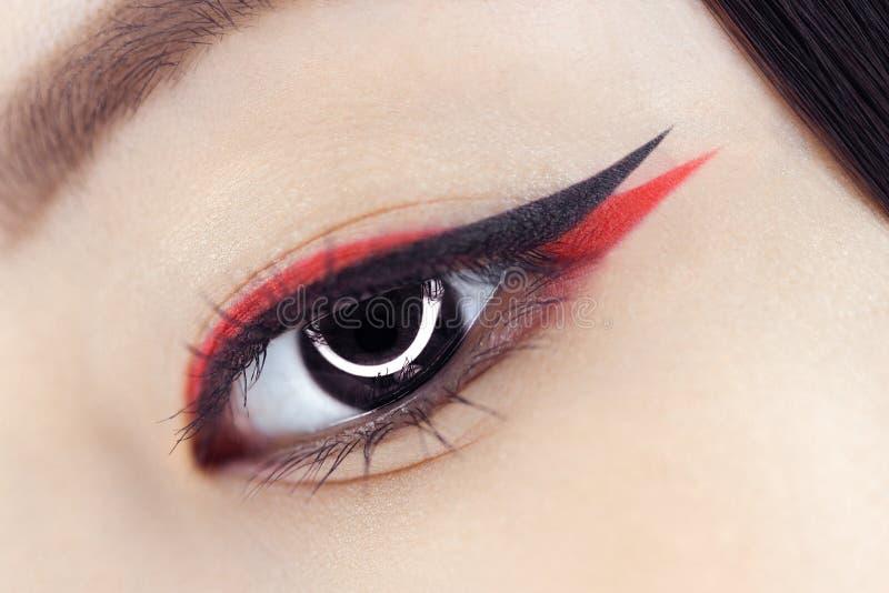Creative fantasy eye makeup macro shot stock photos