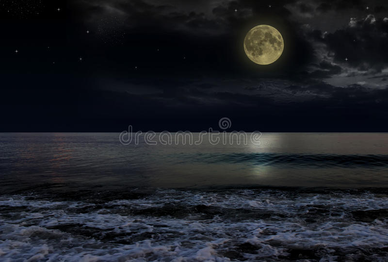 Beautiful magic blue night sky with clouds and full moon stars reflexion in water stock photos