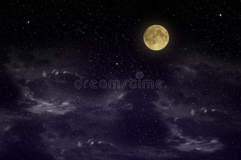 Beautiful magic blue sky with clouds and fullmoon and stars at night closeupr royalty free stock image