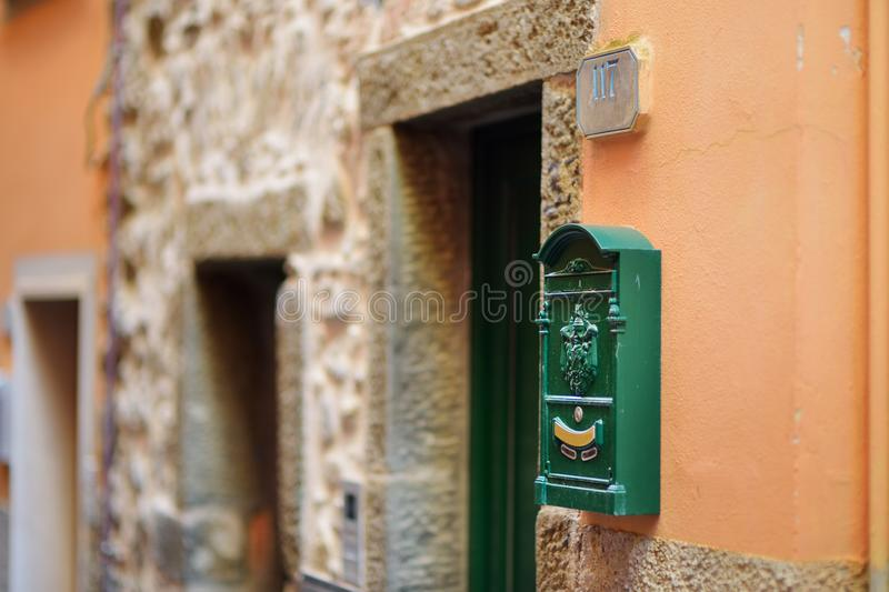 Beautiful mailbox in Riomaggiore, the largest of the five centuries-old villages of Cinque Terre, Italian Riviera, Liguria, Italy. Beautiful mailbox in royalty free stock photography
