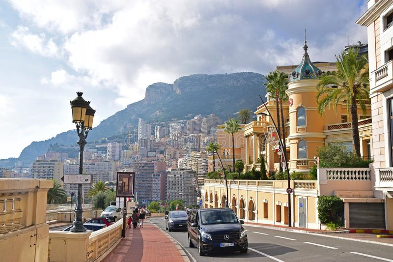Beautiful main road of the Principality of Monaco with spacious, well designed pedestrian walkway and colonial style buildings. Monaco is a sovereign city-state stock photo