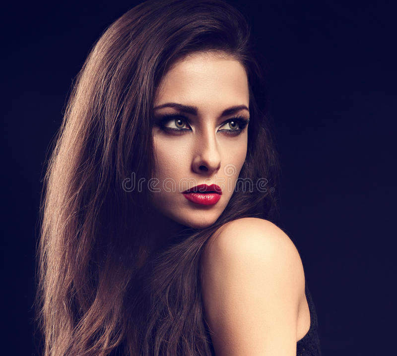 Beautiful makeup expressive female model profile with red lipstick and long eyelashes looking on dark background. Closeup to. Ned portrait. Art stock photos