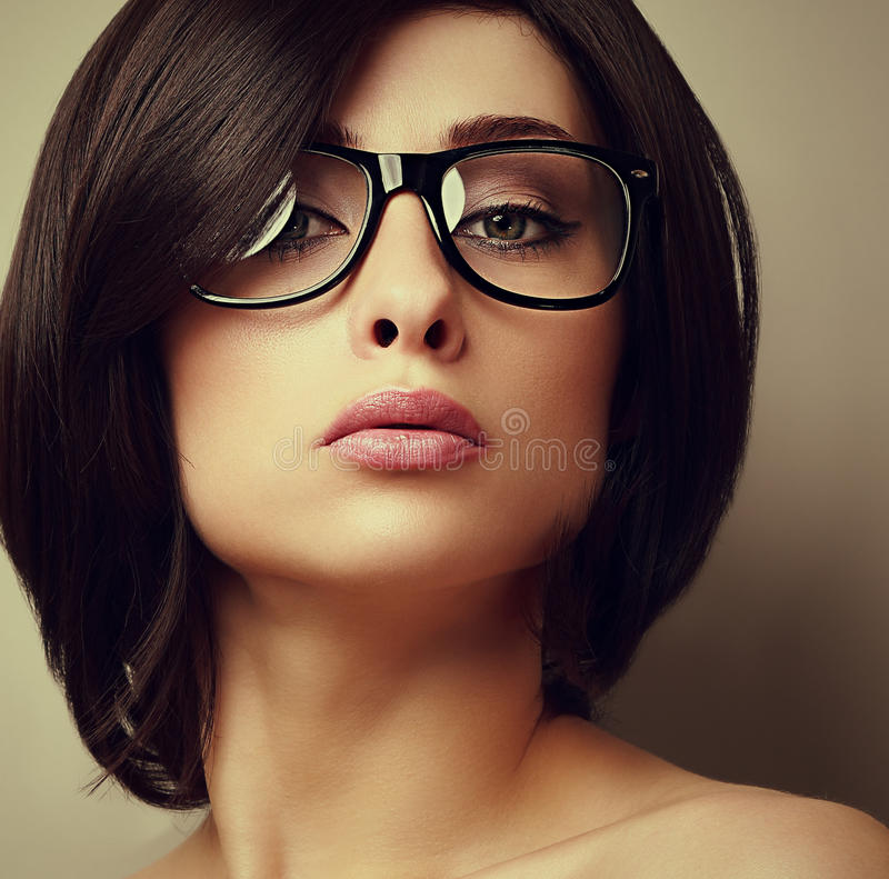 Beautiful makeup fashion girl in modern glasses looking stock photos