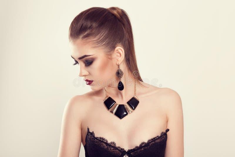 The beautiful makeup girl looking down posing stock photography