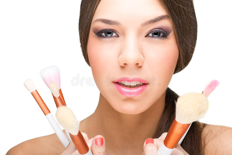 Beautiful makeup model with makeup brushes.  royalty free stock photography