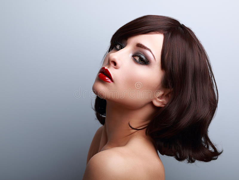 Beautiful makeup profile of black hair woman on blue. Background royalty free stock image