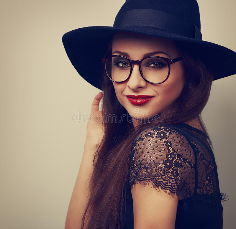 Beautiful makeup woman in fashion black hat and eyeglasses looking with smiling. Toned closeup portrait stock photos