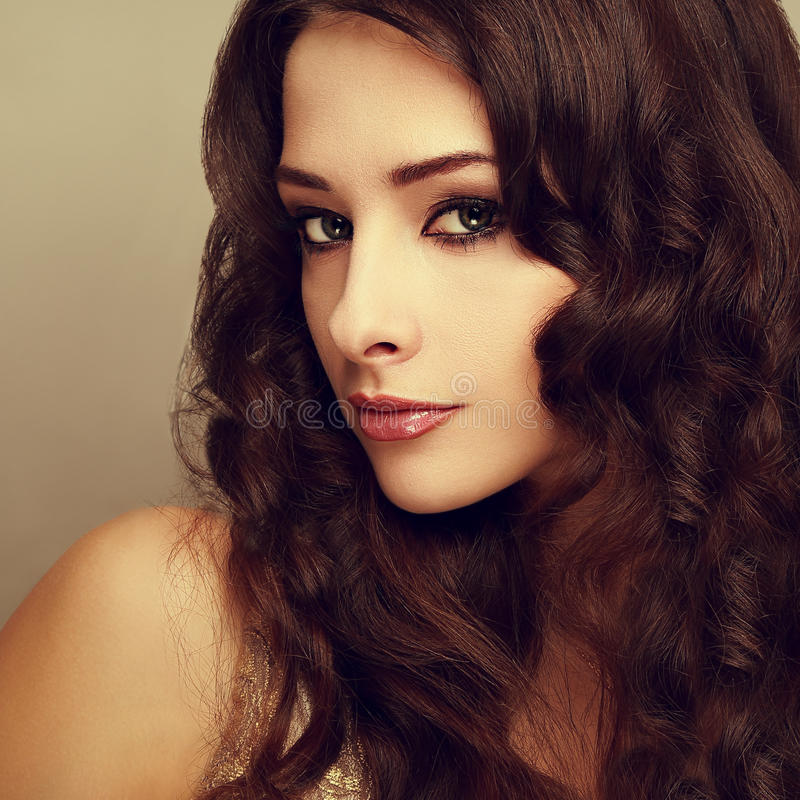 Beautiful makeup woman with long shiny curly hair stock image