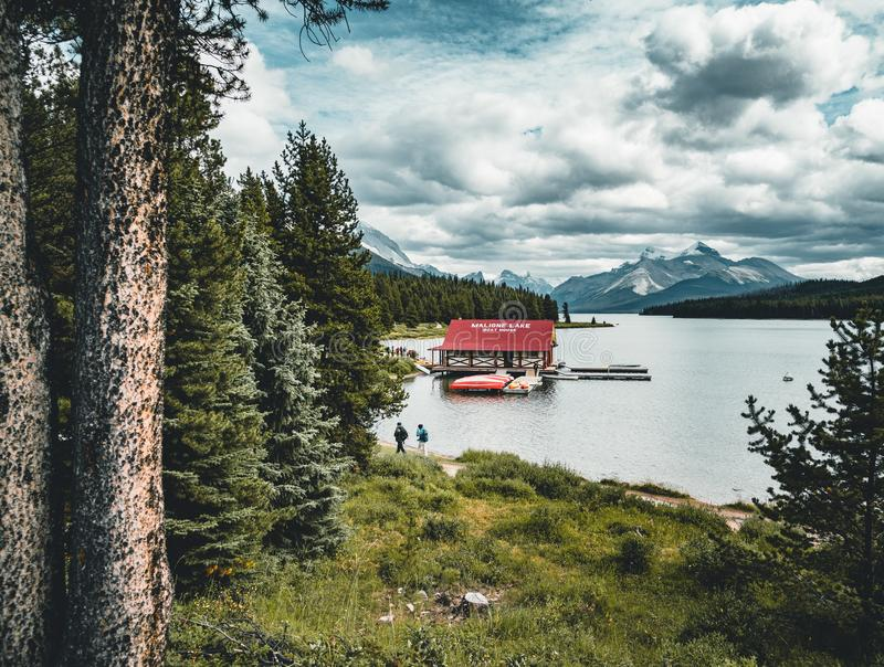 Beautiful Maligne Lake with a boathouse were you can rent canoes and snow covered mountains at the background royalty free stock images