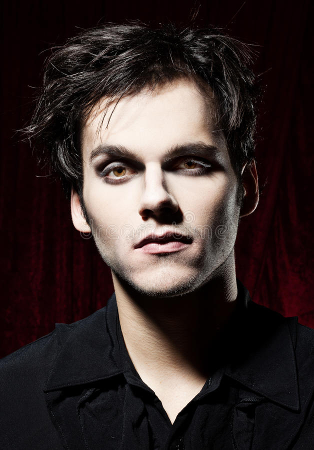 Beautiful man before becoming a vampire stock images