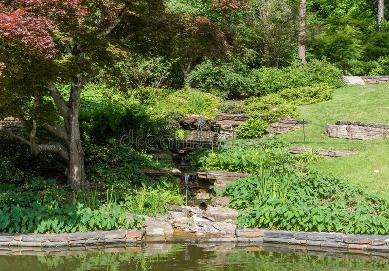 Beautiful man-made stream at a botanical garden in Durham, North Carolina. In springtime stock photos
