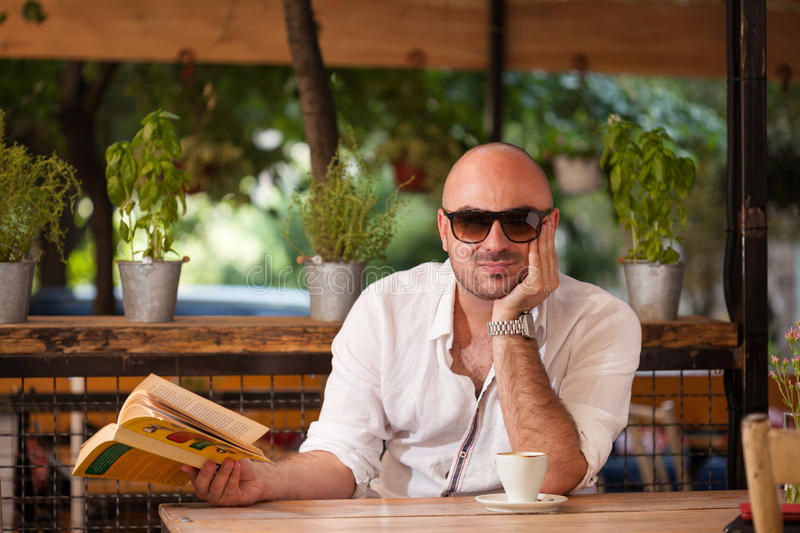Beautiful Man Morning Coffee with a Book stock images