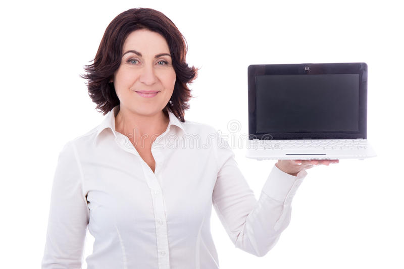 Beautiful mature business woman holding laptop with blank screen. Isolated on white background stock photos