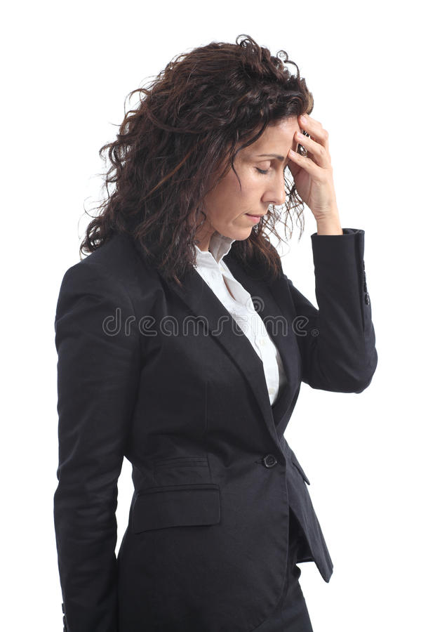Beautiful mature businesswoman stressed with a hea. Dache on a white isolated background stock photography
