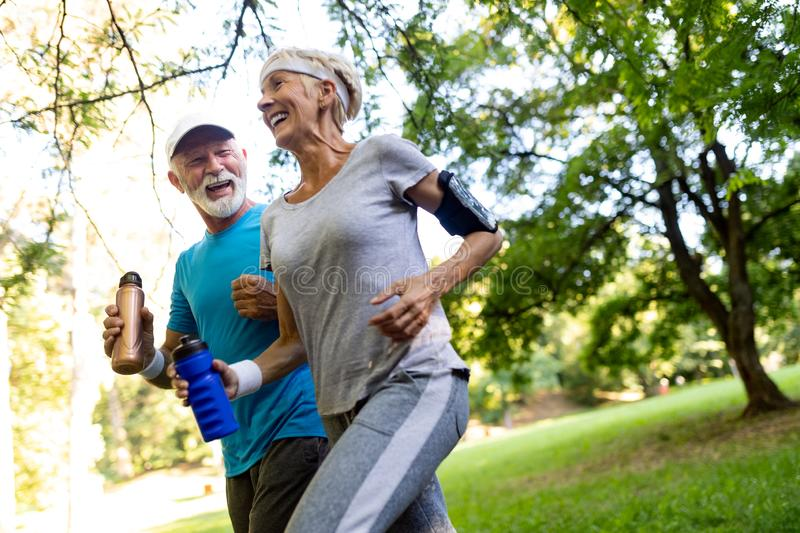 Beautiful mature couple jogging in nature living healthy stock images