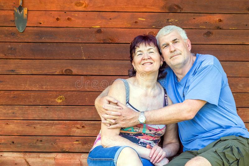 Beautiful mature couple resting on the bench royalty free stock photo