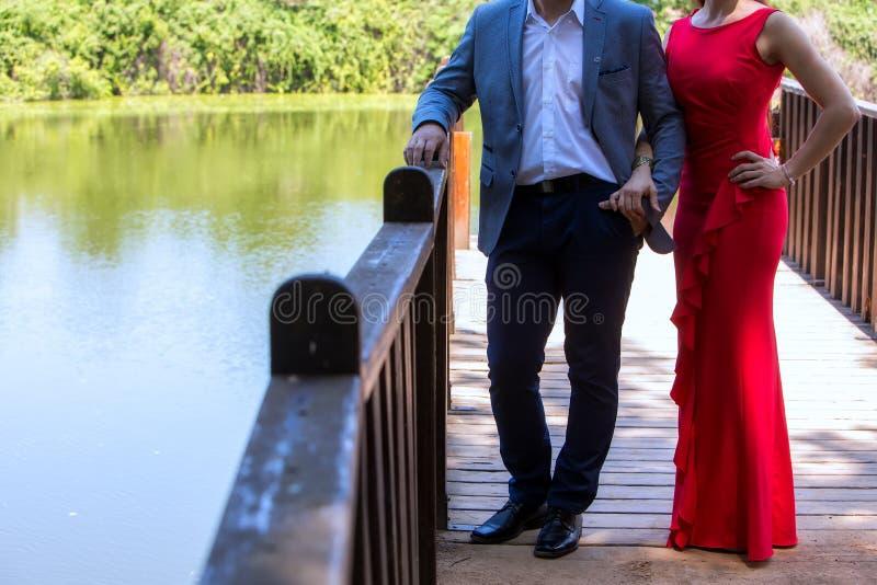 Beautiful mature couple standing near lake royalty free stock photos