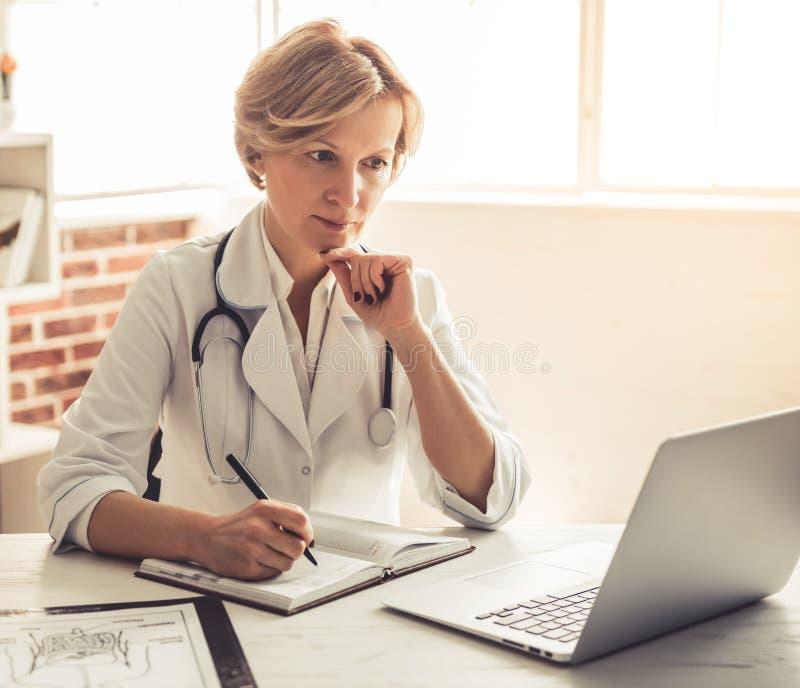 Beautiful mature doctor stock photography