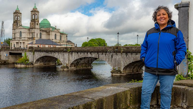 Beautiful mature mexican woman smiling with blue jacket in the city of Athlone in a beautiful spring day royalty free stock images