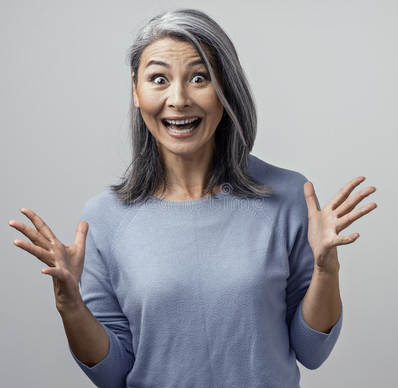 Beautiful mature woman is making funny faces royalty free stock image