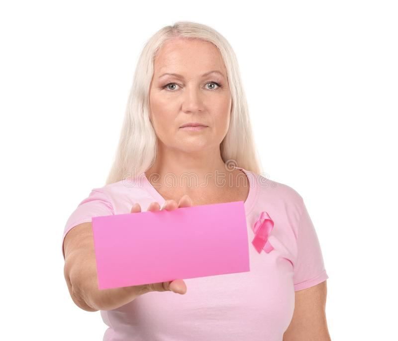 Beautiful mature woman with pink ribbon holding card on white background. Breast cancer concept stock images