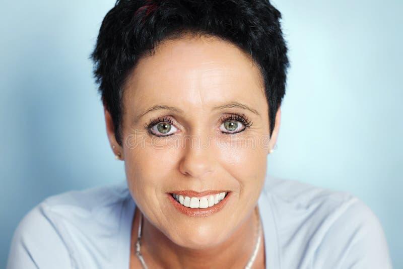 Beautiful mature woman portrait stock photos