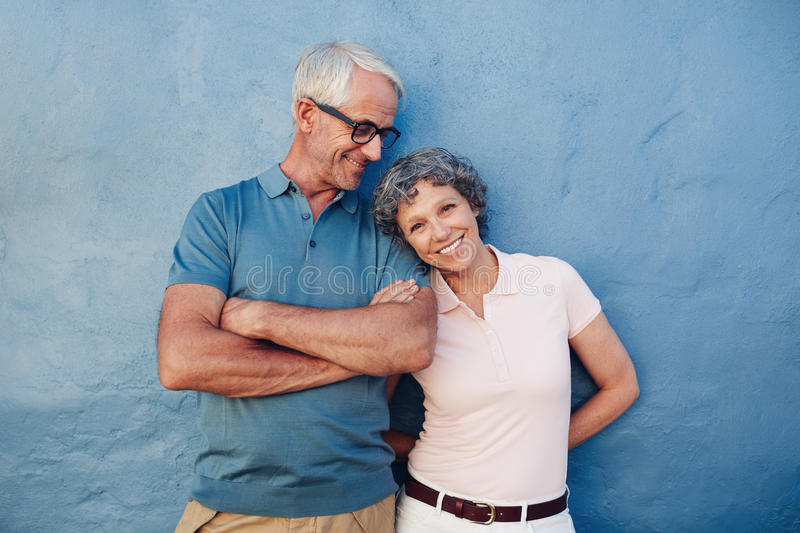 Beautiful mature woman standing with her husband royalty free stock images