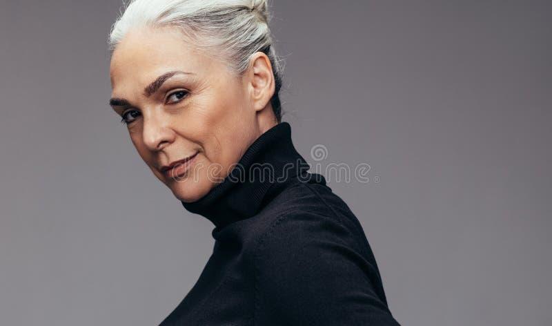 Beautiful mature woman in staring at camera royalty free stock image