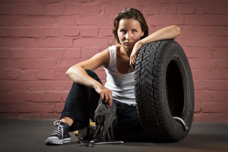Beautiful mechanic in auto repair shop stock photo