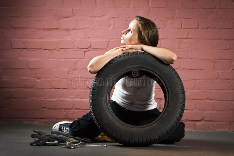 Beautiful mechanic in auto repair shop stock photography