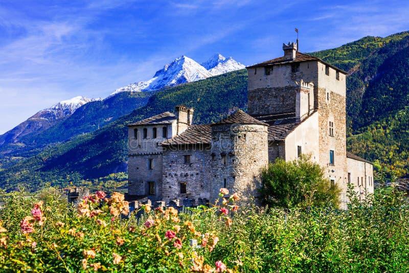 Beautiful medieval castle of Valle d'Aosta - Sarriod de La Tour,. Impressive beautiful old castle with mountains,Sarriod de la Tour,Italy stock photography