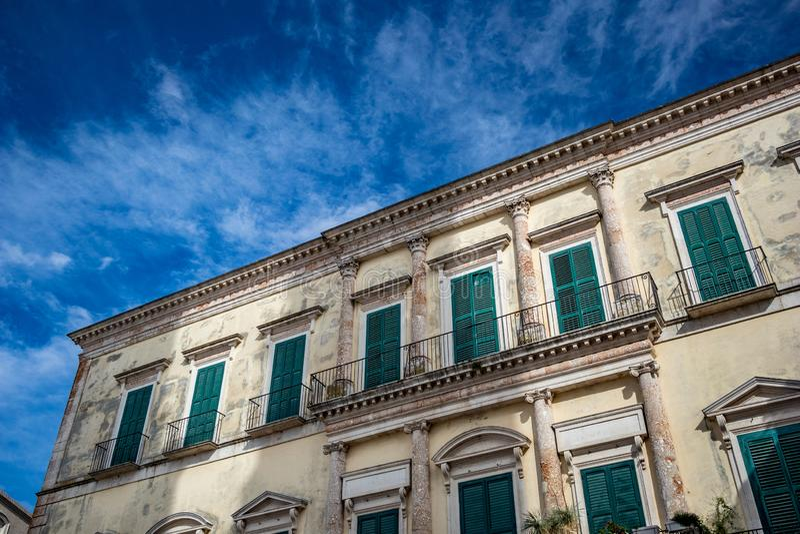 Beautiful medieval facade, Altamura. Puglia. Italy. The beautiful medieval neoclassical facade of Melodia palace or Palazzo Melodia in Altamura. Puglia. Italy stock photography