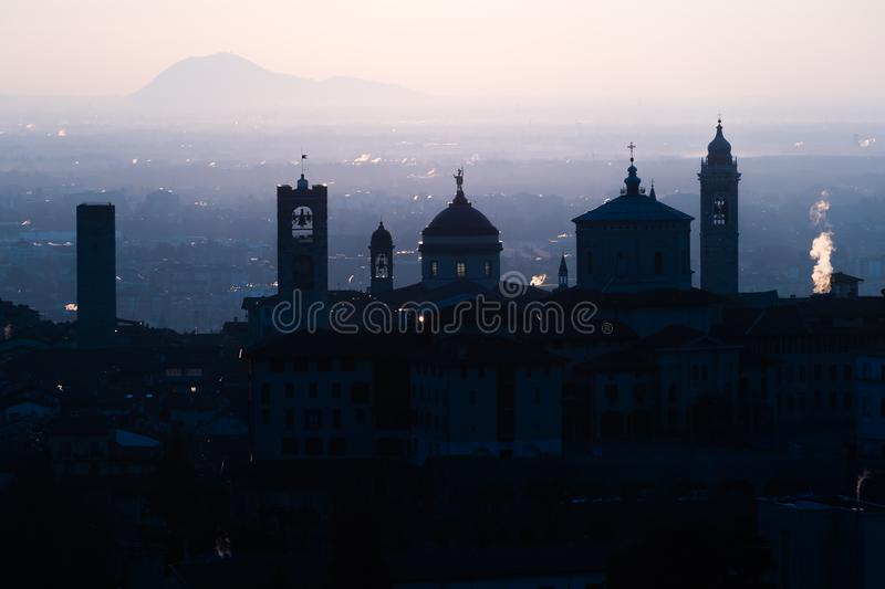 Beautiful medieval town at sunrise morning with main sights of Bergamo Lombardy from Castello di San Vigilio, Italy royalty free stock image