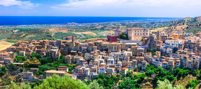 Impressive Corigliano Calabro village,Calabria,Italy. Beautiful Corigliano Calabro village,view with old castle and colorful houses,Calabria,Italy stock photo