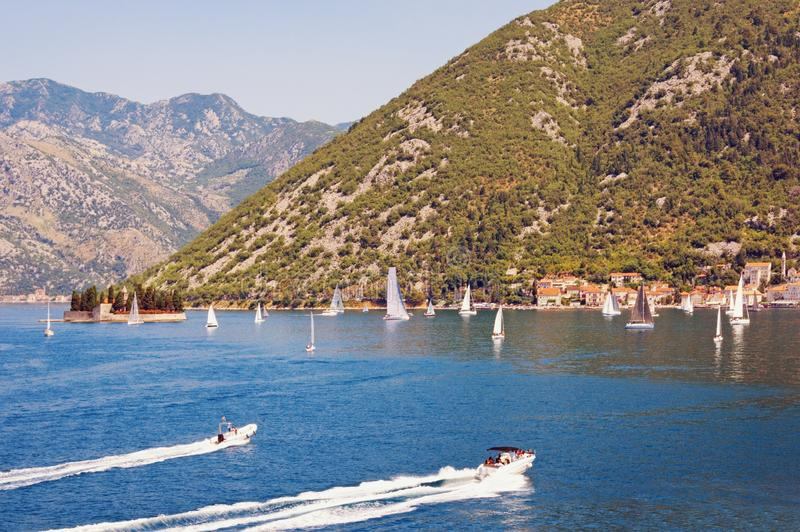 Beautiful Mediterranean landscape with sailboats on water on sunny summer day. Montenegro, Adriatic Sea, Bay of Kotor. Beautiful Mediterranean landscape with stock photos