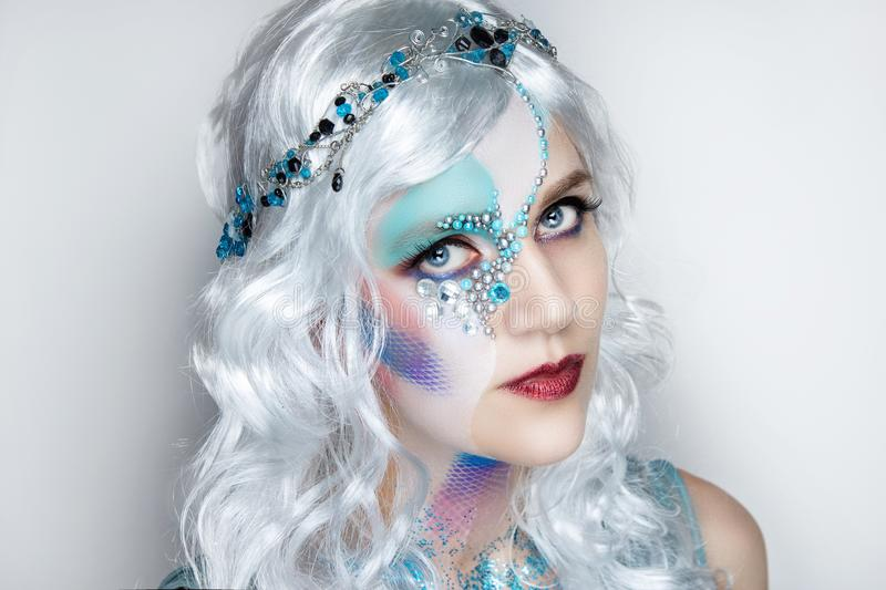 Beautiful mermaid girl in white wig royalty free stock images