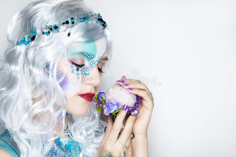 Beautiful mermaid girl in white wig stock photography