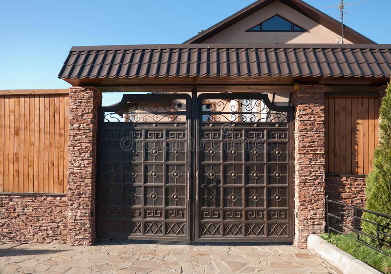 Beautiful metal gates at the cottage royalty free stock photography
