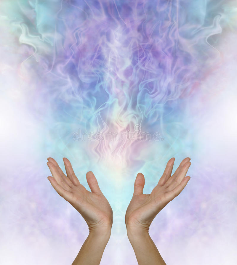 Beautiful Metaphysical Energy Field. Female hands reaching up and out towards a gaseous field of ectoplasmic matter on a turquoise blue purple background with stock photos