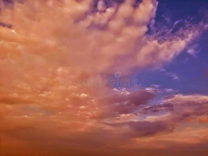Red clouds. Beautiful mezmerizing twilight sunset with red,orange,golden,blue colorful sky and clouds royalty free stock photos