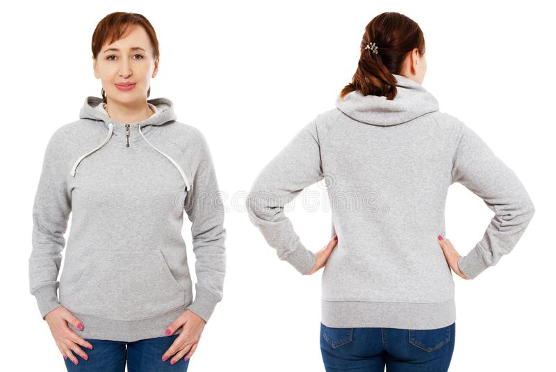 Beautiful middle age woman posing in empty grey hoodie mock up isolated over white background royalty free stock photos