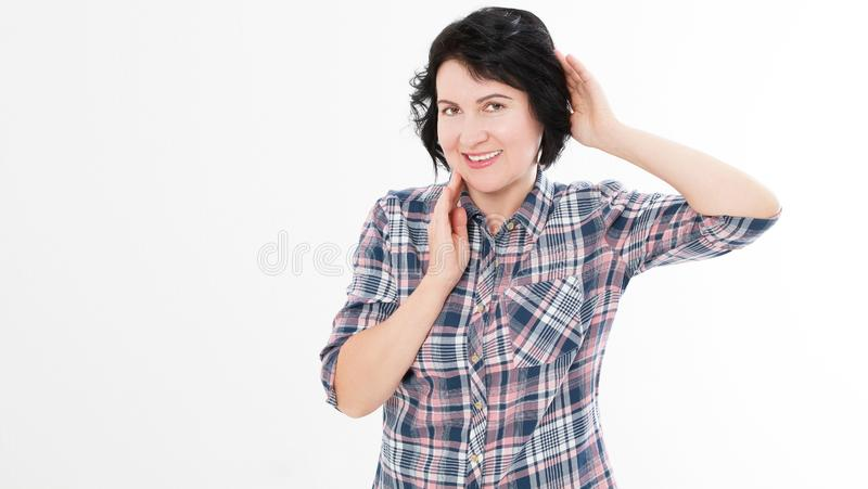 Beautiful middle aged brunette woman touches her neck and hair isolated on white royalty free stock photo