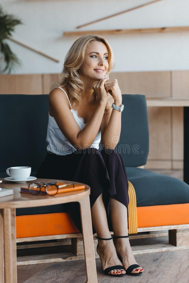 beautiful middle aged businesswoman smiling and looking away stock photos