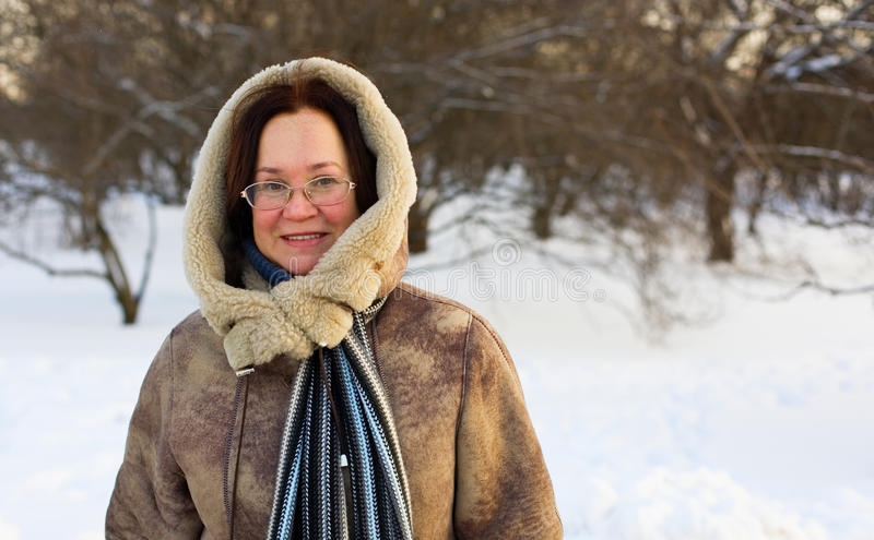 Beautiful middle aged woman. Enjoying winter day stock photos