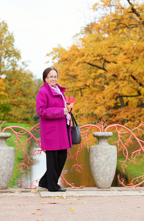 Beautiful middle aged woman in Pushkin. Saint-Petersburg by fall royalty free stock photo